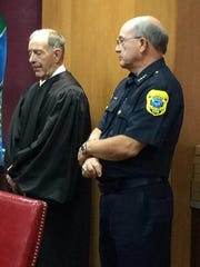 Interim Green Bay Police Chief Jim Lewis listens before his swearing-in ceremony.