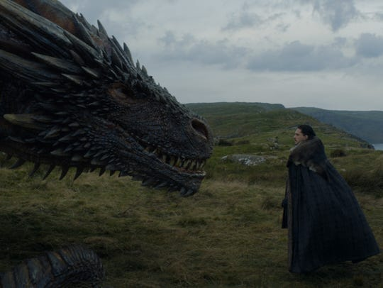 Jon Snow (Kit Harington), right, meets one of Daenerys Targaryen's dragons in HBO's 'Game of Thrones.'
