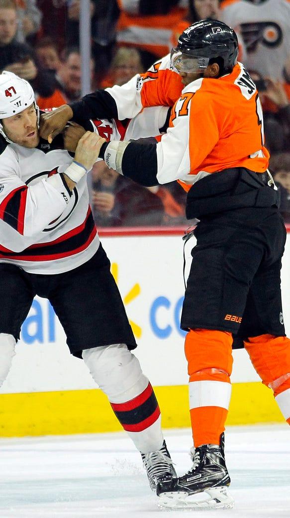New Jersey Devils' Dalton Prout, left, and Philadelphia