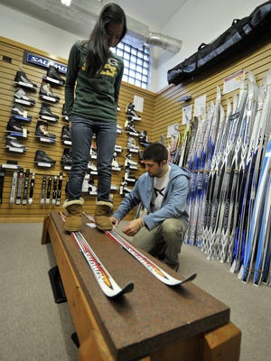 In this 2012 file photo, Matt Haase, right, measures Erin Lemmer's foot for a pair of cross-country skis at Shepherd & Schaller in downtown Wausau.
