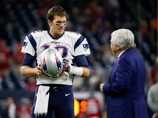 New England Patriots quarterback Tom Brady (12) speaks with owner Robert Kraft before the game against the Houston Texans at NRG Stadium.