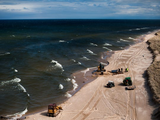 Heavy machinery was busy for most of the morning on Thursday to clean up remaining debris from the recent shipwreck of an old yacht that broke apart along the shores of Lake Michigan just north of the Big Sable Point Lighthouse in Ludington State Park. Date shot: 4/27/17