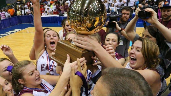 East Webster Lady Wolverine's celebrate following their 68-63 overtime win over West Tallahatchie in the MHSAA Girls State 2A Basketball Championship Finals held in Jackson at the Mississippi Coliseum.