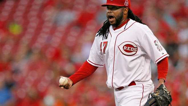 Reds starting pitcher Johnny Cueto argues a balk call with umpire Tom Hallion during the top of the third inning Thursday against the Giants. The call allowed San Francisco to score a run.