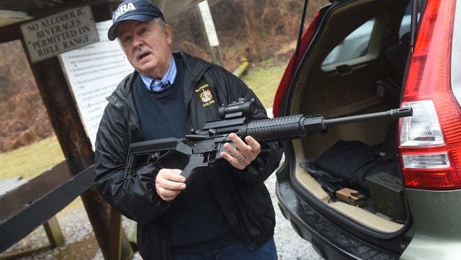 Don Helms, an NRA-certified firearms instructor, talks about his AR-15 before demonstrating its capabilities on a range in Stewartstown. Helms spent 39 years serving different roles with the Baltimore City Police and is now a chaplain for the Fraternal Order of Police.