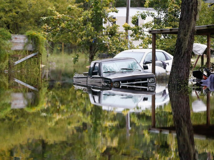 Floodwater surrounds cars in Ridgeville, S.C.