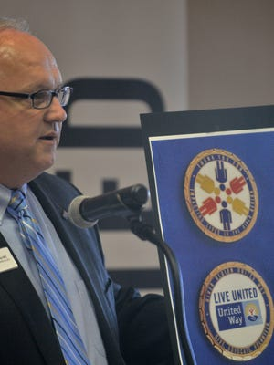 Jimmy Hill, president and CEO of River Region United Way, displays an image of special gold coins that would be presented to special volunteers and supporters for their service in the 2014 fundraising campaign on Wednesday, Jan. 28, 2015, in Montgomery.