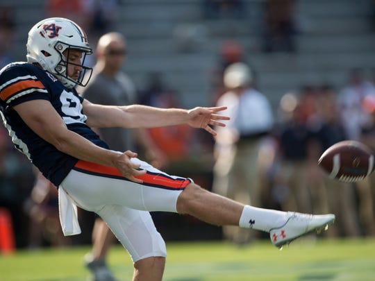 Auburn punter Arryn Siposs (90) punts the ball during the A-Day spring practice gameat Jordan-Hare Stadium in Auburn, Ala., on Saturday, April 13, 2019.  Jc Auburnday 31