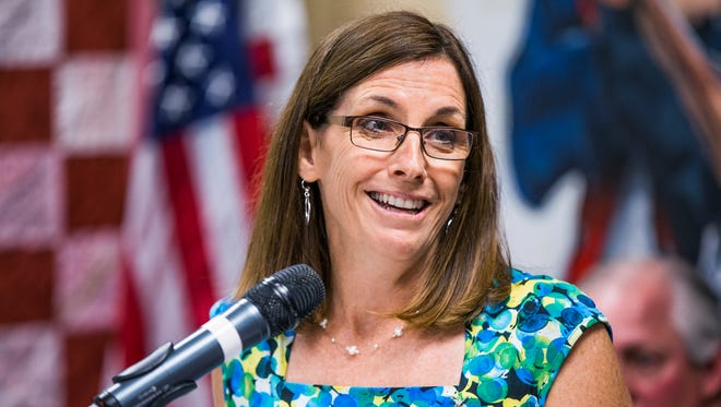 Rep. Martha McSally, R-Ariz., speaks at the grand reopening of a veterans center at the University of Arizona on Aug. 21, 2017.