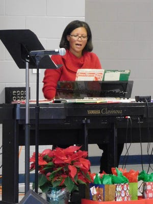 Brenda Rice accompanying the singers at Gretchen Everhart Christmas concert.