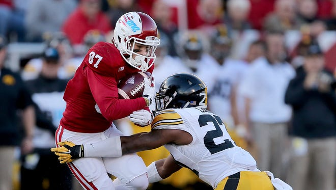 Indiana Hoosiers wide receiver Mitchell Paige (87) runs into the tackle by Iowa Hawkeyes defensive back Jordan Lomax (27) in the first half of their game. The Indiana Hoosiers play the Iowa Hawkeyes Saturday, November 7, 2015, afternoon at Memorial Stadium in Bloomington, IN.