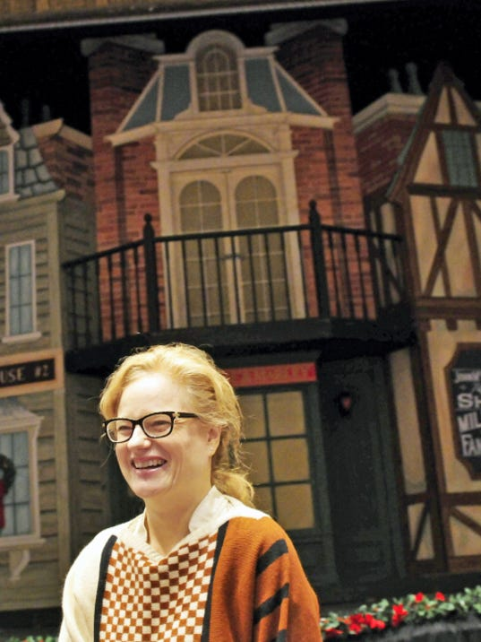 """Stephanie Tack, Capitol Theatre director, stands in front of the """"A Christmas Carol"""" stage in December, 2014. Tack relocated from New York City last year to direct the Chambersburg theater."""