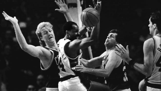 MIlwaukee Bucks guard Sidney Moncrief (center) scrambled for the ball between Boston Celtics forwards Larry Bird and Kevin McHale in the NBA Eastern Conference finals at the Arena in 1986. The Bucks lost the game, 111-98, and were eliminated in the series, 4-1.