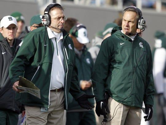 Michigan State defensive coordinator Pat Narduzzi, left, and coach Mark Dantonio talk during a game Nov. 6, 2011, in East Lansing.