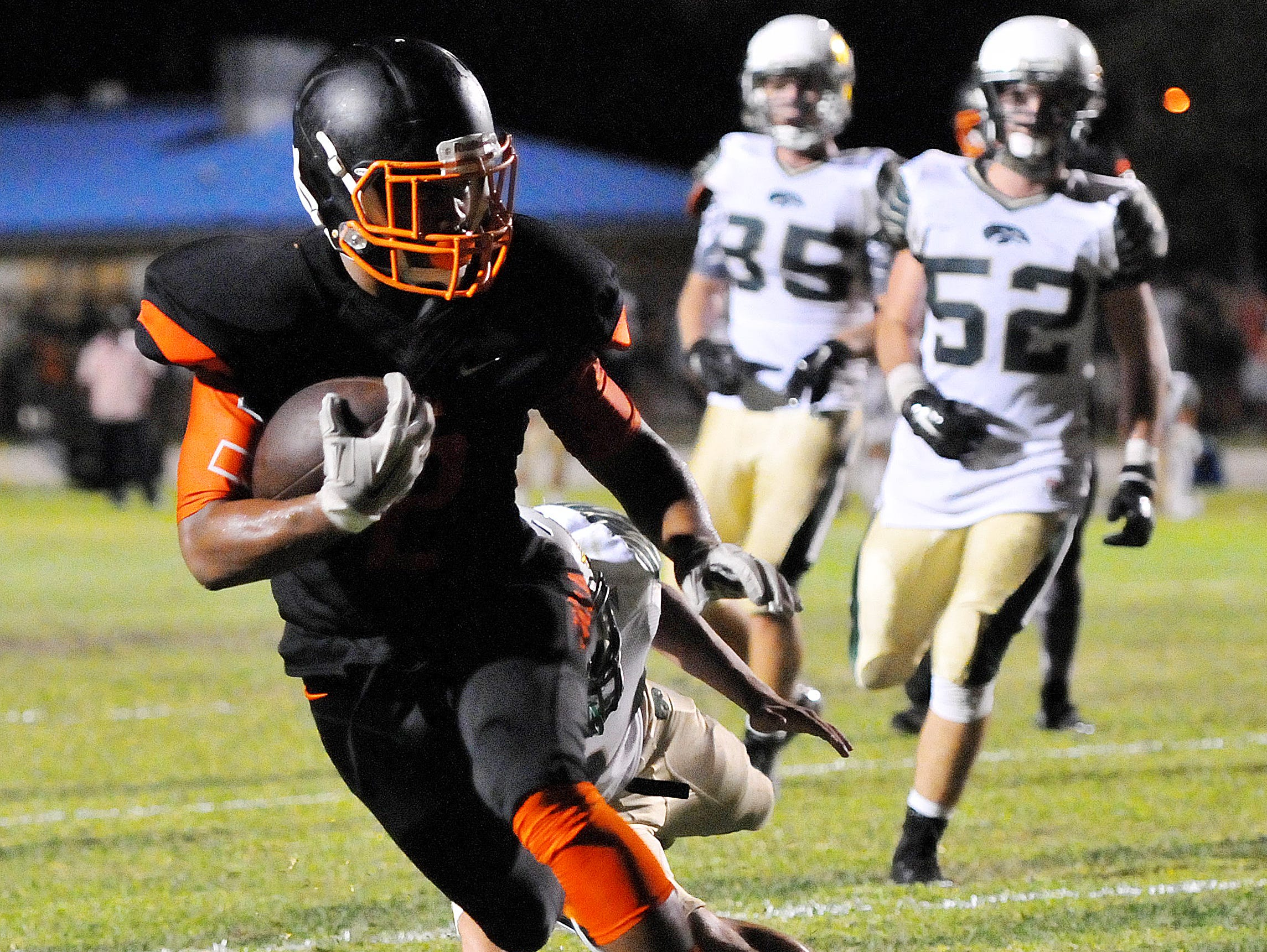 Cocoa Highs #2 Timmy Pratt scores a touch down during Friday nights game against Cocoa High held at Tiger Stadium .