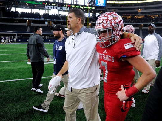 Sweetwater head coach Shane Mobley  consoles rdefensive