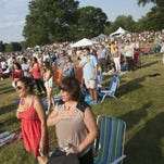 Patrons stand and salute during the National Anthem. Morris Arts hosts the 33rd Annual Giralda Music & Arts Festival at Giralda Farms  featuring the New Jersey Symphony Orchestra. About 2,000 people attended the event on the former Geraldine R. Dodge Estate, Madison, NJ. Sunday, June 26, 2016.
