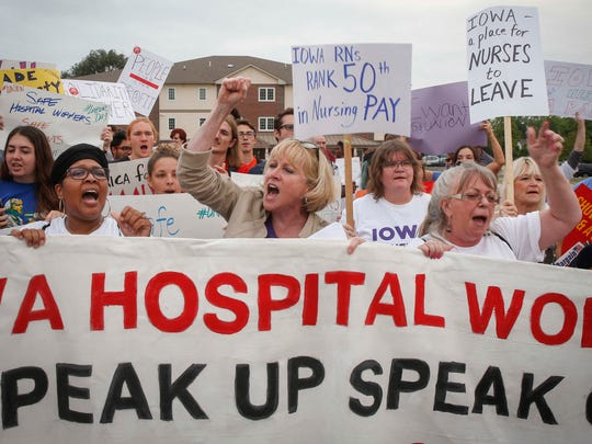 Cathy Glasson, a democratic candidate for governor of Iowa, joined hundreds of Iowans outside of Mercy Medical Center in Des Moines on Monday, Sept. 4, 2017, to protest for union rights, higher minimum wage, and safer working conditions. According the the U.S. Bureau of Labor Statistics' 2016 report, Registered Nurses in Iowa were ranked 50th in salary.