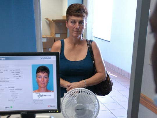 Dyana Williams of Smyrna updates her driver's license