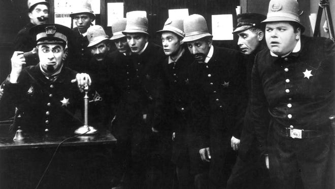 A scene from 'In the Clutches of the Gang', a Keystone Cops silent comedy. Or is it a group of Arizona politicians?