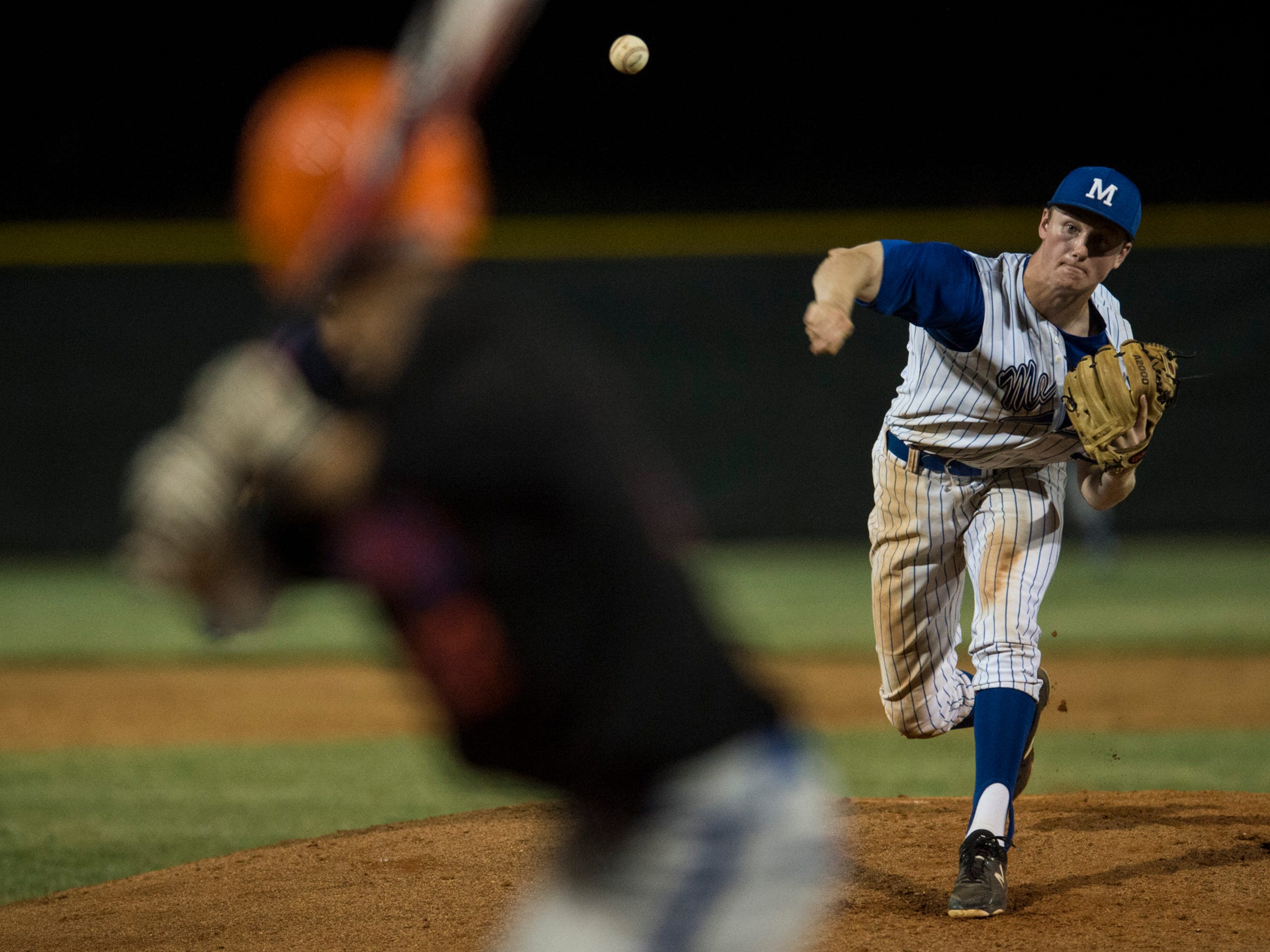 Memorial's Michael Lindauer (22) pitches against Silver