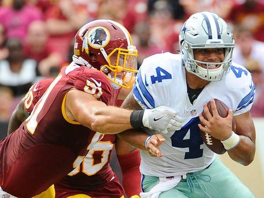 Dallas Cowboys quarterback Dak Prescott (4) is tackled