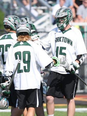 From right, Yorktown's Kyle Casey (15) celebrates a first half goal with teammates against Burnt Hills in the Class B state regional semifinal lacrosse game at Yorktown High School June 1, 2016. Casey finished the day with 7 goals and 5 assists. Yorktown won the game 16-9.