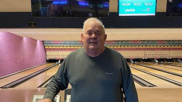 Jerry Held stands in front of the lanes at Monroe Sport Center, the family business. Held was recently inducted into the Michigan United States Bowling Congress Hall of Fame.