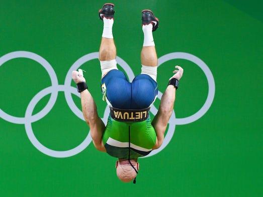 Aurimas Didzbalis (LTU) during the men's weightlifting
