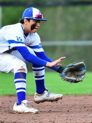Lakeland sophomore shortstop Trent Farquhar gets ready to make the pick-up.
