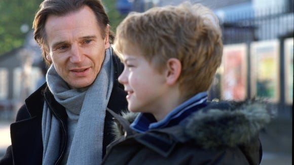 Liam Neeson and Thomas Brodie-Sangster in a scene from