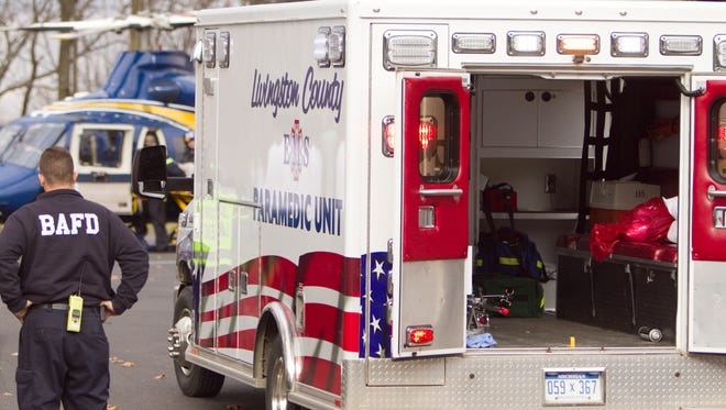 Two Livingston County paramedics and a patient were transported to an Ann Arbor hospital after the ambulance crashed Sunday due to an ice-covered roadway.