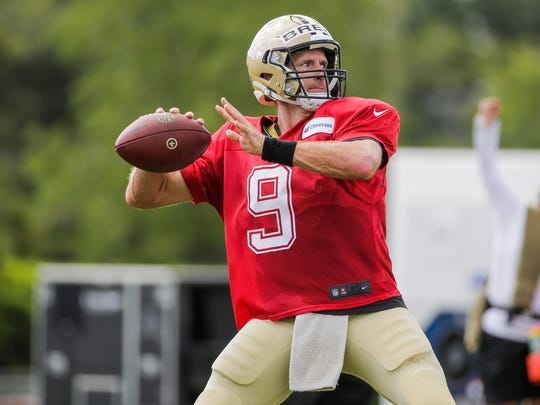 New Orleans Saints quarterback Drew Brees (9) throws a pass during training camp at the Ochsner Sports Performance Center.