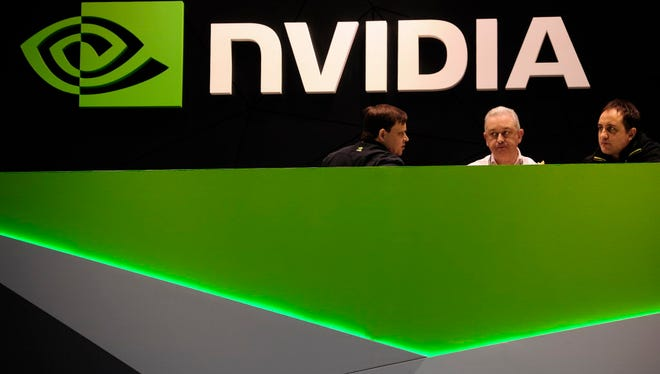 People gather in the Nvidia booth at the Mobile World Congress, the world's largest mobile phone trade show in Barcelona, Spain, Thursday, Feb. 27, 2014.