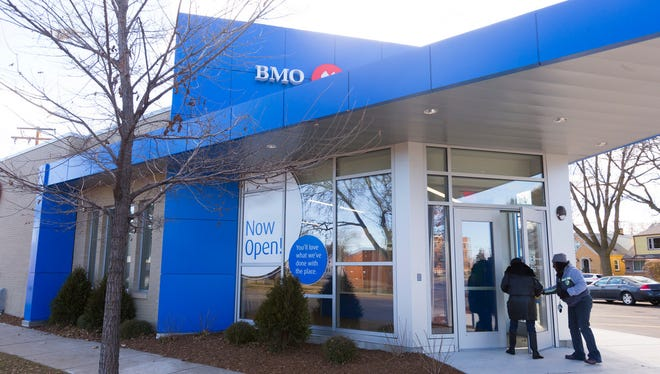 BMO Harris Bank has opened a new branch across the street from a bank office that was damaged by fire in Sherman Park unrest more than a year ago.