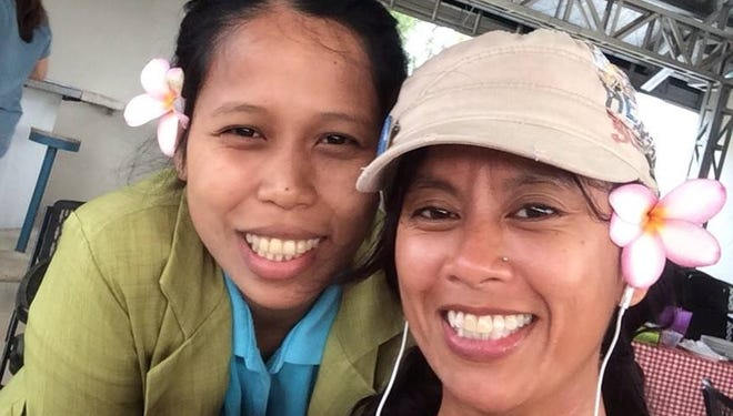 Raela takes a selfie at breakfast with Carmel Cenabre, the hotel manager at the Holy Trinity Pension House in Talibon, Bohol.