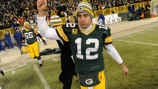 Green Bay Packers quarterback Aaron Rodgers (12) reacts after the Packers beat the Detroit Lions 30-20 at Lambeau Field in Green Bay, Wisc., on Dec. 28.
