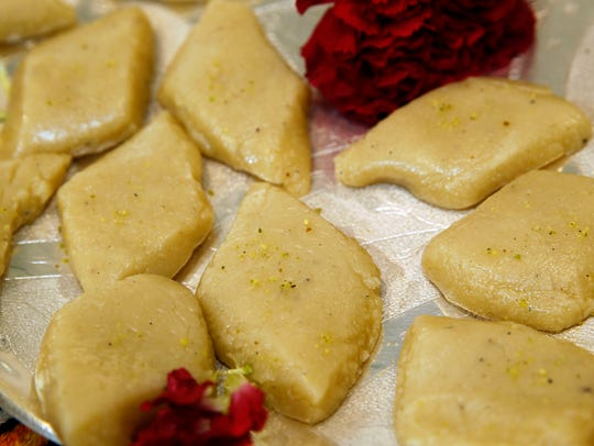 Almond burfi, a no-bake sweet, are flavored with cardamom