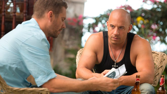 Brian (Paul Walker, left) and Dom (Vin Diesel) share their traditional barbecue in 'Fast & Furious 6.' We should all aspire to their brotherhood.