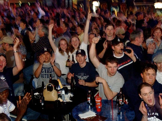 In this 2004, Nevada fans howl for the Wolf Pack at