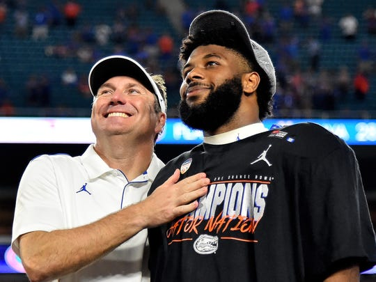 Dec 30, 2019; Miami Gardens, Florida, USA; Florida Gators head coach Dan Mullen (L) and game MVP Florida Gators running back Lamical Perine (R) celebrate after defeating the Virginia Cavaliers at Hard Rock Stadium. Mandatory Credit: Jasen Vinlove-USA TODAY Sports