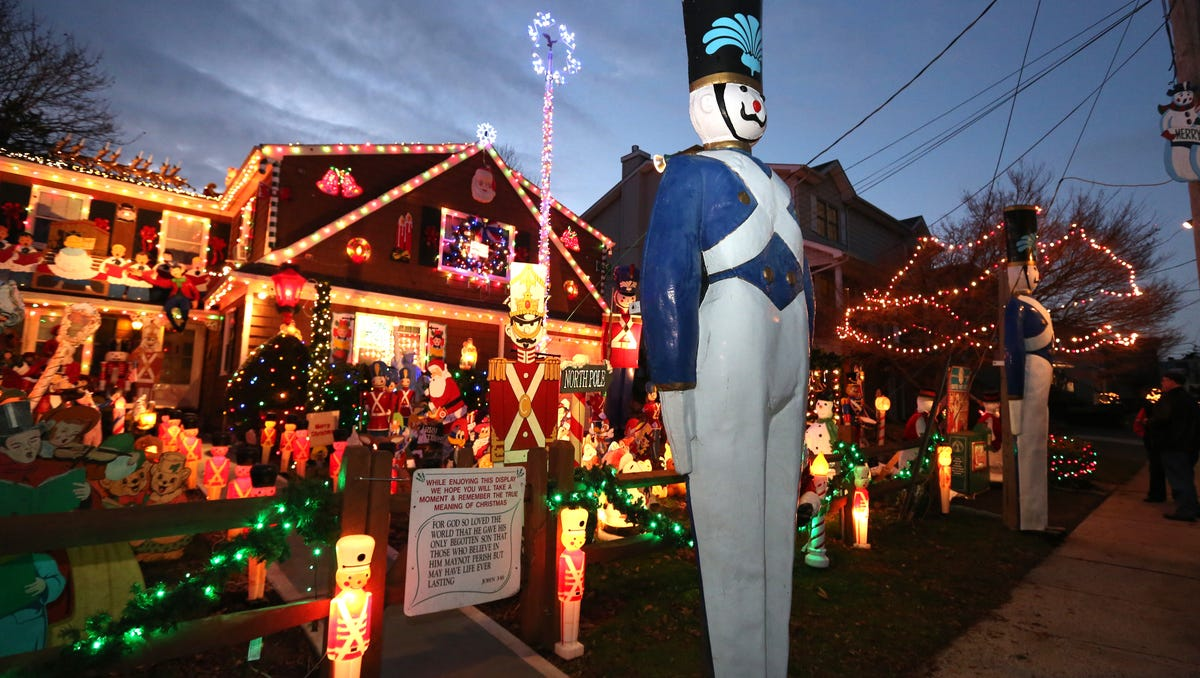 Roy Aletti decorates his Parsons Street, Harrison, home for Christmas, Dec. 7, 2016. He lends his tall wooden soldiers to Rye Playland after Christmas.