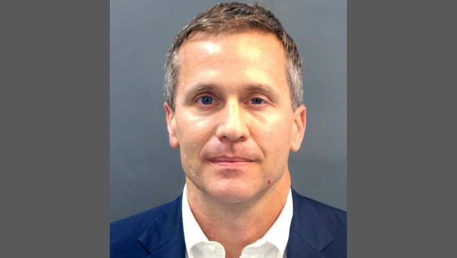 A booking photo provided by the St. Louis Metropolitan Police Department shows Missouri Gov. Eric Greitens on Thursday, Feb. 22, 2018. A St. Louis grand jury has indicted Greitens on a felony invasion of privacy charge for allegedly taking a compromising photo of a woman with whom he had an affair in 2015, the city circuit attorney's office said Thursday. Greitens' attorney issued a scathing statement challenging the indictment. (St. Louis Metropolitan Police Department/St. Louis Post-Dispatch via AP)