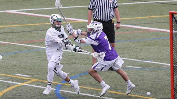 Yorktown's Jamison Embury (3) fires off a shot in front of John Jay's George McMichael (7) during the boys lacrosse Section 1 Class B championship game at Mahopac High School May 26, 2017. Yorktown won the game 14-6.
