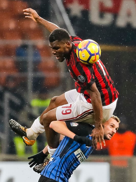 AC Milan's Franck Kessie, top, jumps for a ball over Inter Milan's Marcelo Brozovic during an Italian Cup quarter-final soccer match between Milan and Inter Milan at the San Siro stadium in Milan, Italy, Wednesday, Dec. 27, 2017. (AP Photo/Antonio Calanni)