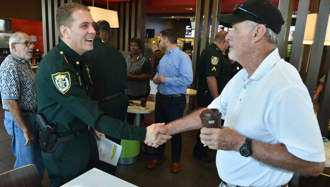 Indian River County Sheriff's Office deputies met residents July 12, 2017, to answer questions and discuss local issues over coffee and breakfast during Coffee with a Deputy Day at McDonald's on 53rd Street and U.S. 1 in Vero Beach.