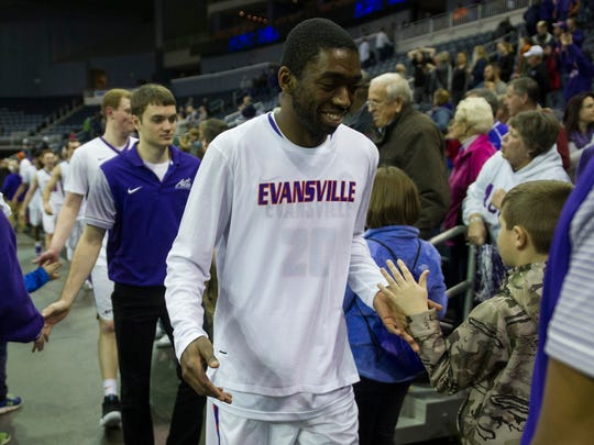 Evansville Jared Chestnut high fives fans after the game at the Ford Center on Wednesday, Jan. 31, 2018. The Purple Aces defeated the Panthers 57-49.