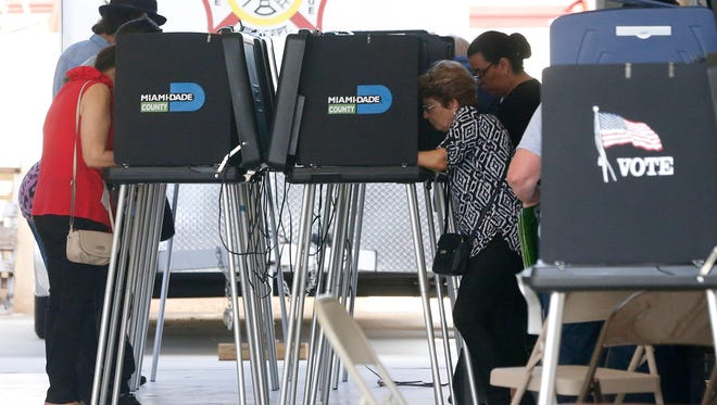 South Florida voters cast their ballots at a polling center in Miami, Florida on November 6, 2018.