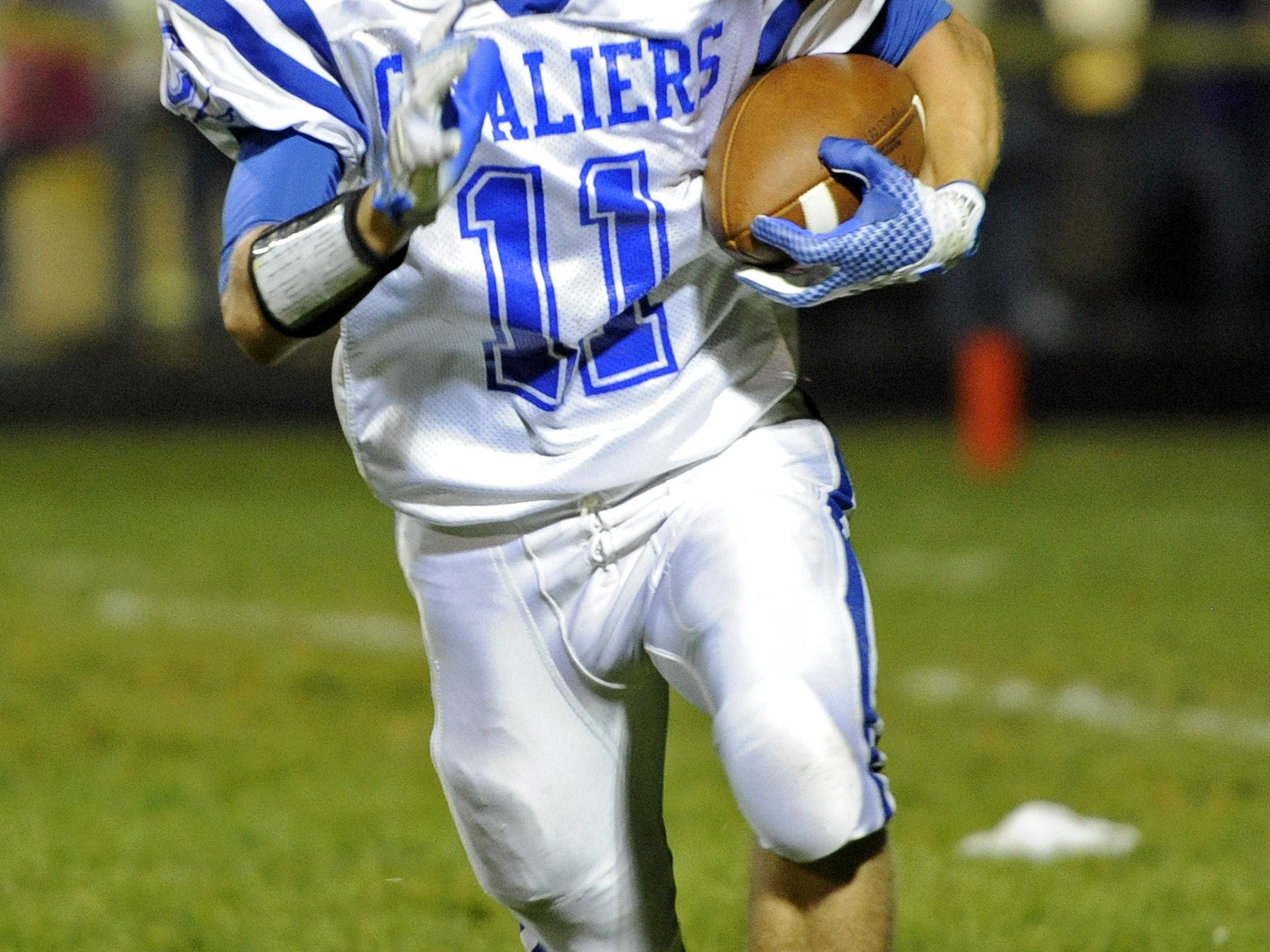 Chillicothe running back Nate Rosenbauer carries the ball during the first half of a 2014 game against McClain. Rosenbauer will be at the center of the Cavaliers' offensive plans in 2015.