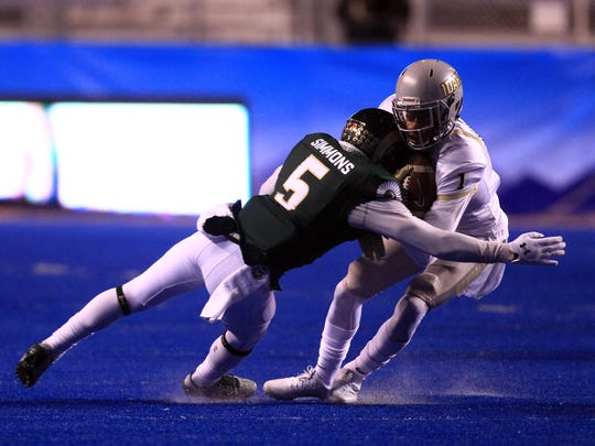 Dec 22, 2016; Boise, ID, USA; Colorado State Rams defensive back Tyree Simmons (5) attempts to tackle Idaho Vandals wide receiver Alfonso Onunwor (1) during first half action at the Idaho Potato Bowl held at Albersons Stadium. Mandatory Credit: Brian Losness-USA TODAY Sports